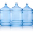 Three big bottles of water isolated on a white background — Stock Photo #46433963
