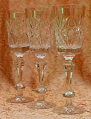 Glassware for drinks 3 pieces illuminated with colored filters — Stock Photo