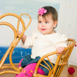 Little girl on a horse rocking chair — Stock Photo #12308694