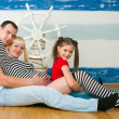 The image of a happy family expecting the second child — Stock Photo