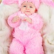 Funny newborn baby dressed in Easter bunny suit — Stock Photo