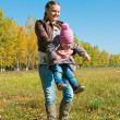 The young woman with the daughter on walk — Stock Photo