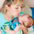 Mother kisses the child — Stock Photo