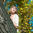 Stock Photo: Girl on poplar