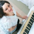 The pregnant woman near a piano — Stock Photo