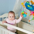 Baby in children's to a bed — Stock Photo