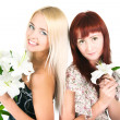 Girls with lilies — Stock Photo