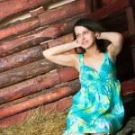 Girl sitting on hay — Stock Photo #16306965