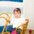 Little girl on a horse rocking chair — Stock Photo #16792029