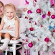 The girl with parents at the Christmas fir-tree with gifts — Stock Photo #22250827
