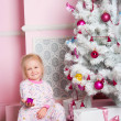 The girl at the Christmas fir-tree with gifts — Foto Stock