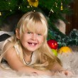 Royalty-Free Stock Photo: The girl under the Christmas fir-tree
