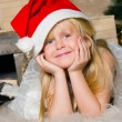 Stock fotografie: The girl under the Christmas fir-tree