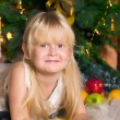 Stockfoto: The girl under the Christmas fir-tree