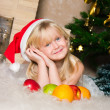 The girl under the Christmas fir-tree — Foto Stock