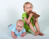 Young girls eating bar of chocolate — Stock Photo
