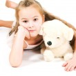 The girl with a toy puppy — Stock Photo