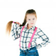 Girl with long braid in a plaid shirt and jeans - Stock Photo