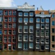 Facade of houses in Amsterdam  — Stock Photo