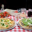 Feast time to start - pizza on the table — Stockfoto