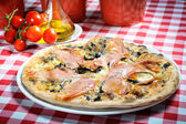 Pizza with ham and other additives — Stock Photo