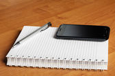 Tradition and modernity notebook and smartphone — Stock Photo