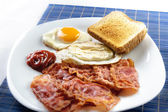 Egg and bacon with toast — Stock Photo