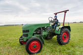 Young boy on a tractor — Foto de Stock