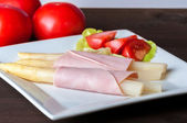 Asparagus with ham — Stock Photo