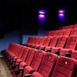 Red seats of cinema hall — Stock Photo #10959776