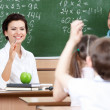 Teacher questions pupils at algebra — Stock Photo #12418961