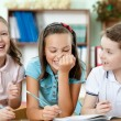 Постер, плакат: Laughing pupils help to each other