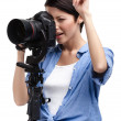 Creative girl-photographer takes shots — Stock Photo