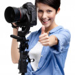 Pretty woman-photographer takes pictures — Stock Photo