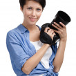 Pretty woman-photographer takes snaps — Stock Photo