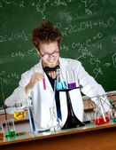 Mad professor holds a vial — Stock Photo