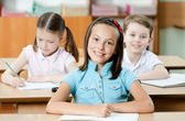 Pupils are glad to study — Stock Photo
