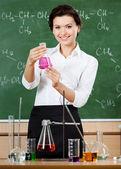 Smiley chemistry teacher — Stock Photo