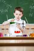 Little chemist conducts an experiment — Stock Photo