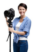 Woman-photographer takes images — Stock Photo