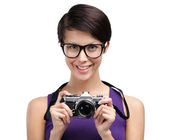 Pretty woman hands retro photographic camera — Stock Photo