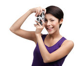Competent woman hands retro photographic camera — Stock Photo