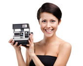 Lady takes photos with cassette photographic camera — Stock Photo