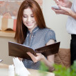 Stock Photo: Pretty woman makes an order