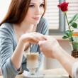 Woman at the cafe hand in hand with her boyfriend — Stockfoto
