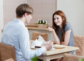 Woman talks with man at the coffee house — Stock Photo