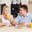 Husband and wife eat in the kitchen — Stock Photo