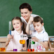 Little pupils study chemistry at laboratory class — Stock Photo