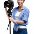 Stock Photo: Competent woman-photographer takes pictures