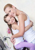 Mother and daughter hug each other in bathroom — Stock Photo